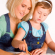 Mom and girl drawing - Stockfoto