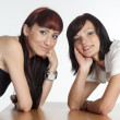 Two girls on table — Stock Photo