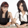 Girls and money - Stock Photo
