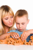 Mom plays with son — Stock Photo