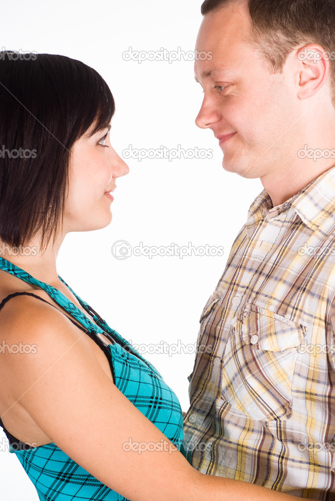 Happy cute couple posing on a white — Stock Photo #6154393