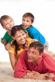 Family on carpet — Stock Photo