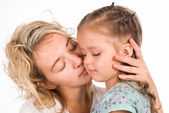 Mom kisses daughter — Stock Photo