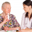 Royalty-Free Stock Photo: Nurse and aged patient