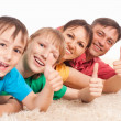 Stock Photo: Family on carpet