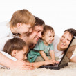 Family with computer — Stock Photo #6353090
