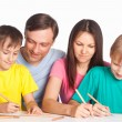Family drawing at table — Stock Photo