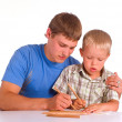 Dad drawing with son - Stock Photo