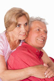 Old couple on white — Stockfoto