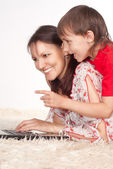 Mom and son with laptop — Stock Photo