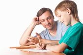 Son draws with dad — Stock Photo