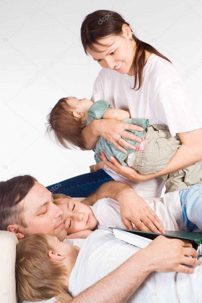 Portrait of a sleeping family on a white — Stock Photo #6352751