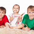 Three children drawing — Stockfoto