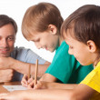 Stock Photo: Dad draws with sons