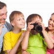 Happy family with camera — Photo