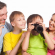 Happy family with camera — Stock Photo #6436889