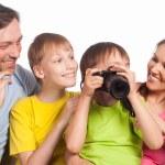 Happy family with camera — Stock Photo