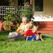 Grandsons with grandparents playing — Stock Photo