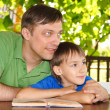 Dad with son reading — Stock Photo