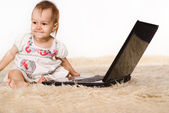 Baby and laptop — Stock Photo