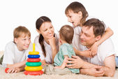 Family of a five on carpet — Stock Photo