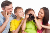 Happy family with camera — Stock Photo