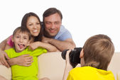 Boy taking picture of family — Stock Photo