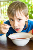 Young boy eating — Stock Photo