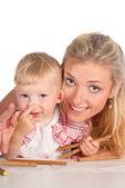 Mom draws with baby — Stock Photo