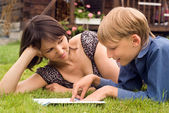 Mom and son reading — Stock Photo