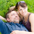 Cute couple on grass — Stock Photo
