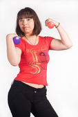 Girl with dumb bells — Stock Photo