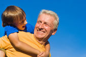 Old man with grandchild — Stock Photo