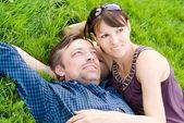 Cute couple on grass — Stock Photo