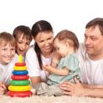Family on carpet — Stock Photo #6496307