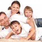 Family on carpet — Stock Photo