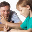 Dad draws with son - Stock Photo