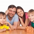 Stock Photo: Cute family playing at table