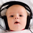 Baby music listening - Stock Photo
