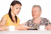 Aged mom with daughter — Stock Photo