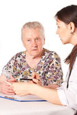 Nurse and granny chatting — Stock Photo