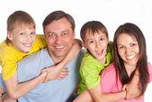 счастливая семья на белом — Стоковое фото
