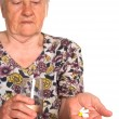 Stock Photo: Granny with medicine