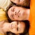 Happy family on carpet — Stock Photo #6579177