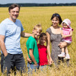 Family of a five at field — Stock Photo #6579979