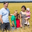 Family of a five at field — Stock Photo