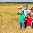 Nice family at field — Stock Photo #6579982