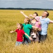 Cute family at field — Stock Photo #6579991