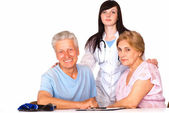 Nurse and family smiling — Stock Photo