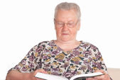 Granny with book — Stock Photo
